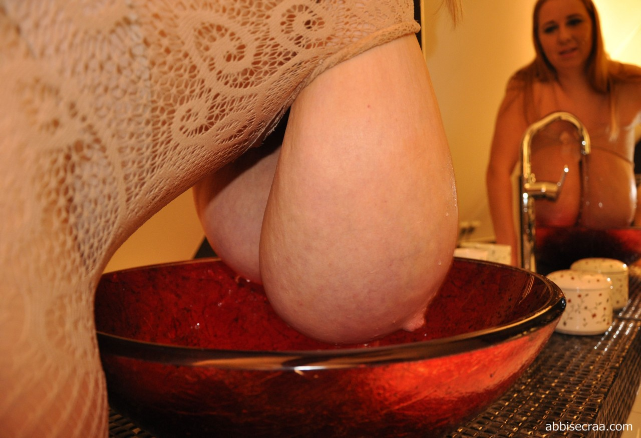 Washing Her Breasts - photos