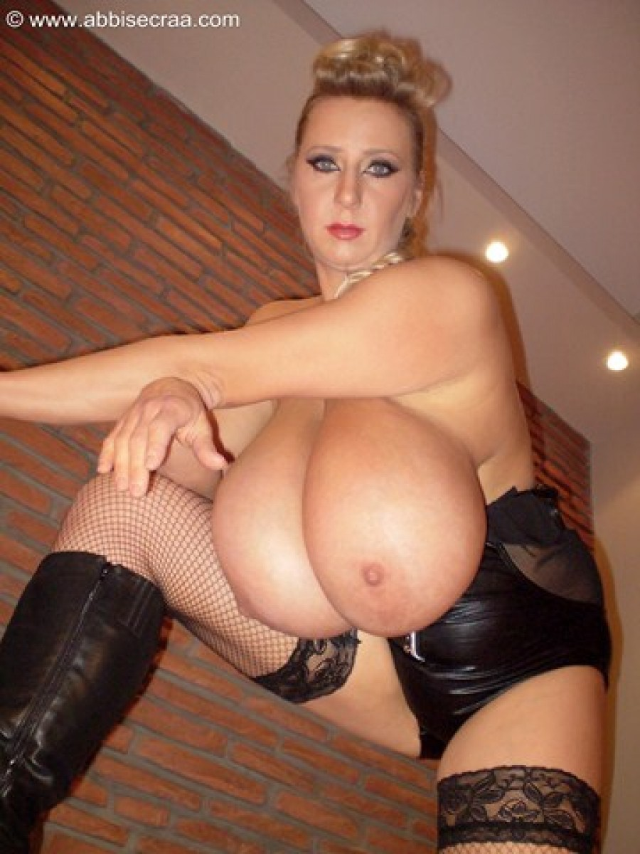 Two large breasts, four walls..photos